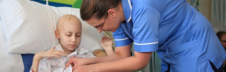 Girl being looked after by nurse